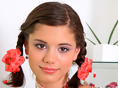 Pigtailed legal age teenager Caprice playing with her pink and moist 18yo snatch on camera