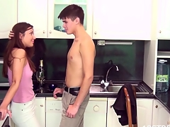 Hawt legal age teenager honey bows in kitchen to welcome penis unfathomable inside